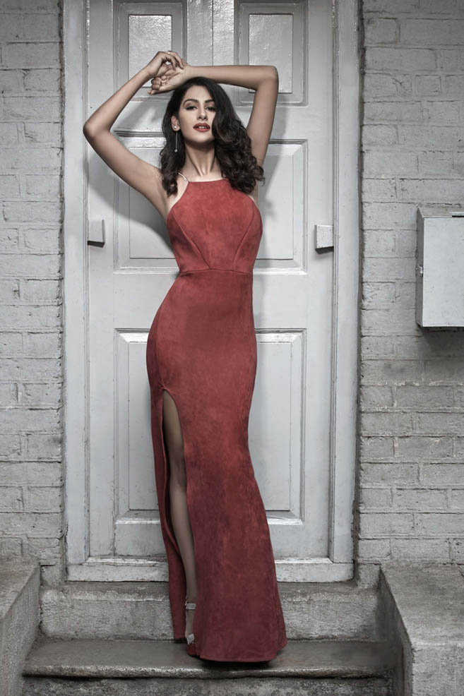Indian fashion model Aarushi Gupta photographed in an elegant red evening dress