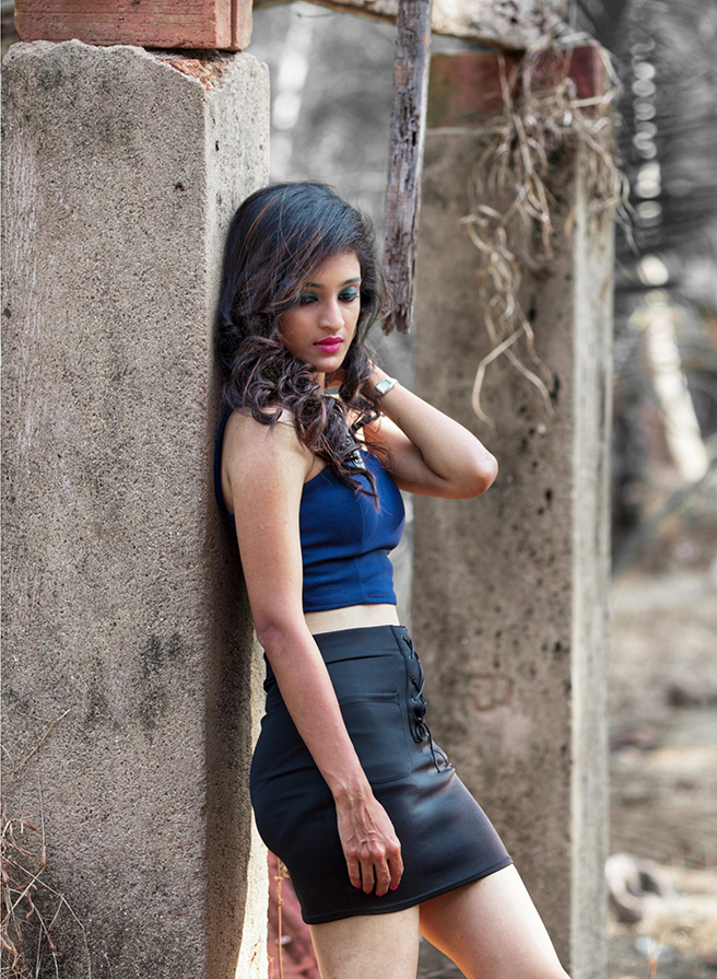 Indian model Ashika kulal wearing a blue top with a black mini skirt