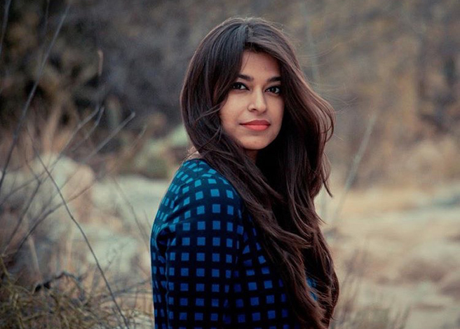 Stunning Indian American model Mehak Narang in a blue sweater