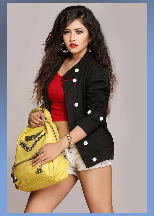 Stunning Guwathati based model Priya Chettri wearing denim shorts with a red top and a black jacket