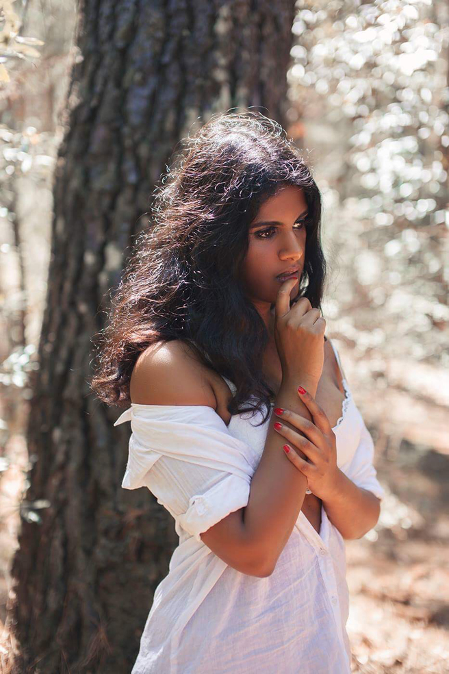Indian model Revathi Shan photographed in the forest wearing an elegant white dress